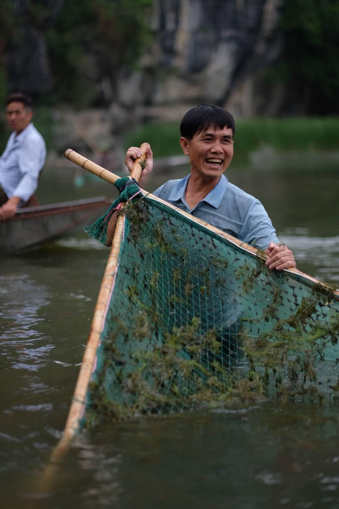 pescador no rio tam coc